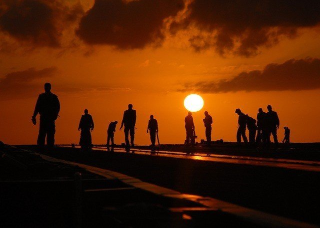 A group of people standing in front of a sunset - which of them do you want to speak to through social media marketing?