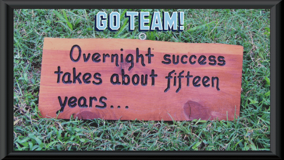 Overnight success doesn't exist! Self-improvement will help it  Image of a sign in the middle of the grass